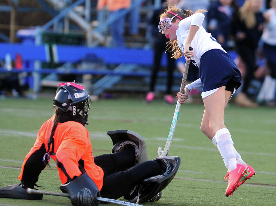 Wilton goalie Lizette Roman-Johnston stops a goal attempt by Lauralton Hall's Kara Duggan, during Class M girls state field hockey championship against Lauralton Hall in Wethersfield, Conn. on Saturday March 16, 2013. Photo: Christian Abraham / Connecticut Post