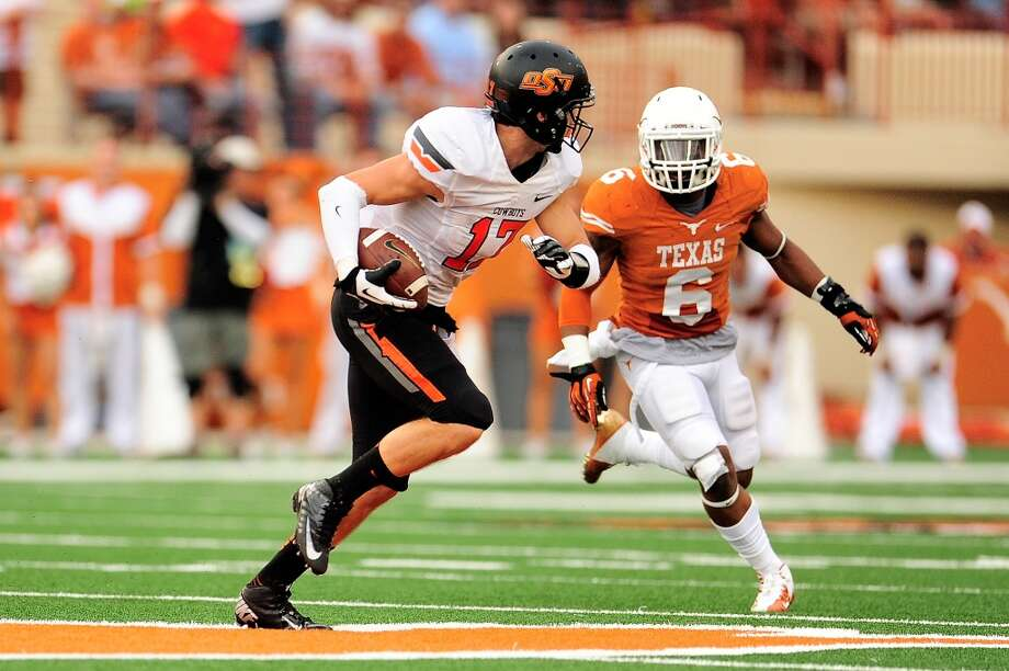 Oklahoma State 38, Texas 13 Record: 7-3  Quandre Diggs of the Longhorns pursues Charlie Moore of Oklahoma State. Photo: Stacy Revere, Getty Images
