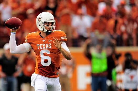 Texas quarterback Case McCoy winds up to throw a pass against Oklahoma State. Photo: Stacy Revere, Getty Images