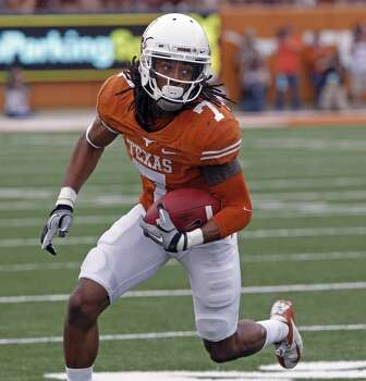 Michael Thomas of the Longhorns looks to make a play with the ball against Oklahoma State. Photo: Michael Thomas, Associated Press