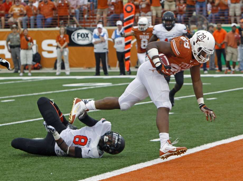 Texas running back Michael Brown scores a touchdown against Oklahoma State. Photo: Michael Thomas, Associated Press
