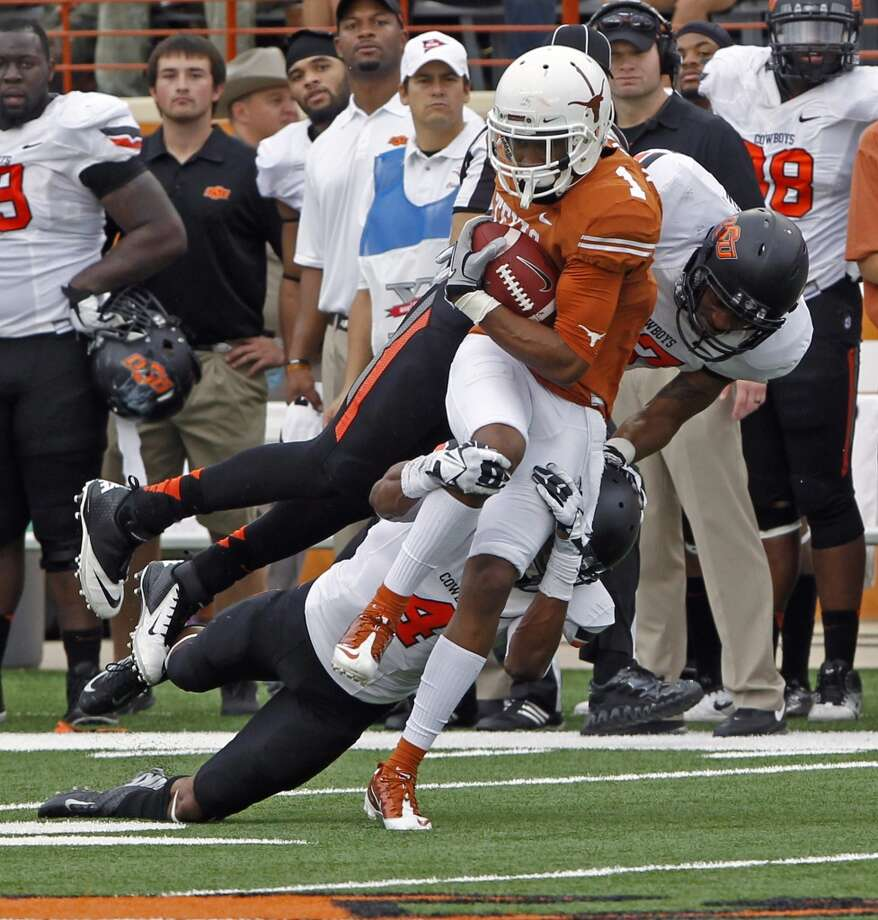 Texas receiver Mike Davis makes a catch against Oklahoma State. Photo: Michael Thomas, Associated Press
