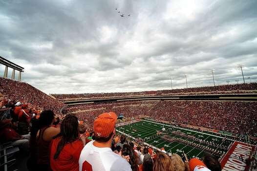 A military flyover prior to the Longhorns matchup with Oklahoma State at Darrell K. Royal-Texas Memorial Stadium. Photo: Stacy Revere, Getty Images