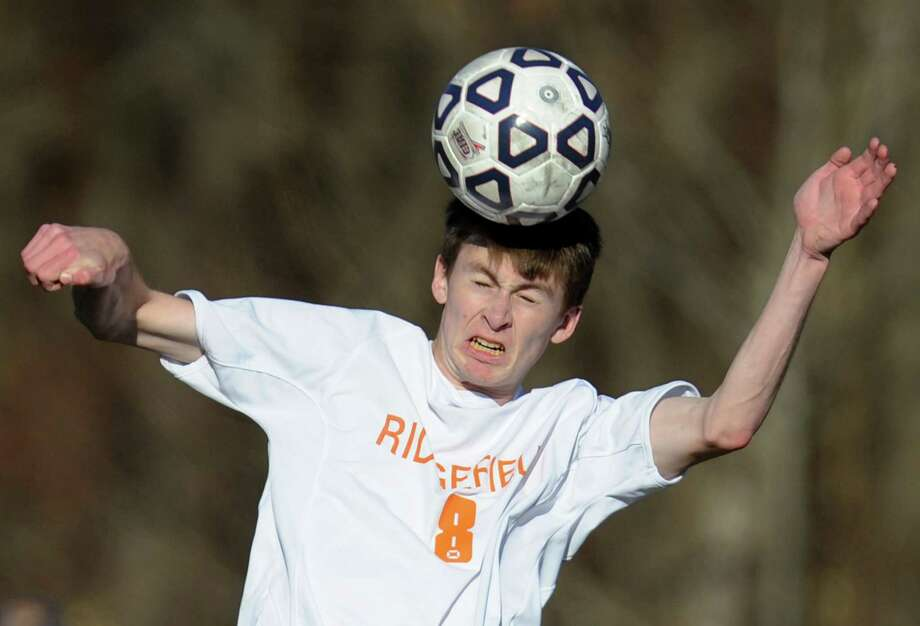 Ridgefield's Daniel Standish (8) hits a header in Ridgefield's 1-1 tie with Glastonbury in the CIAC Class LL high school boys soccer championship game at Municipal Stadium in Waterbury, Conn. on Saturday, Nov. 16, 2013. Photo: Tyler Sizemore / The News-Times