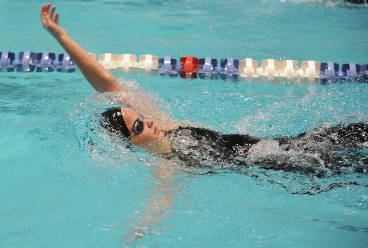 Amity's Megan Lasto races in the 200 Yard Intermediate Medley Saturday, Nov. 16, 2013 at the CIAC Open Championship at Yale's Kiputh Pool in New Haven, Conn.