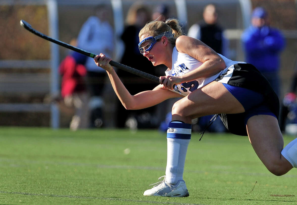 Darien's Hollis Perticone follows through on a penatly shot which got past Cheshire to score, during Class L girls state field hockey championship in Wethersfield, Conn. on Saturday March 16, 2013.