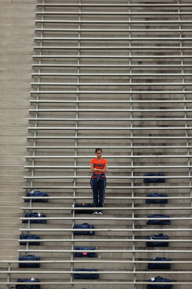 A Bush High School fan watches warm-ups before a high school football bi-district playoff game against Clear Creek, Saturday, November 16, 2013, at Abshier Stadium in Deer Park. Photo: Eric Christian Smith, For The Chronicle