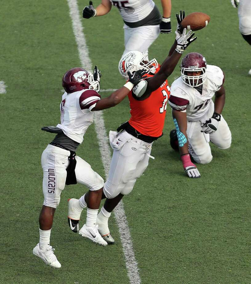 Bush's Olasunkanmi Adrniyi, right, intercepts a pass intended for Clear Creek's Da'Von Smith and returns it thirty-two yards for a touchdown during the second half of a high school football bi-district playoff game, Saturday, November 16, 2013, at Abshier Stadium in Deer Park. Photo: Eric Christian Smith, For The Chronicle