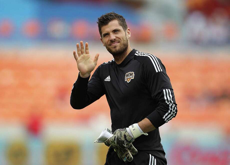 Dynamo goalkeeper Tally Hall met his wife, Erica, while both played soccer at San Diego State University. Erica was a midfielder. Photo: James Nielsen, Staff / © 2013  Houston Chronicle