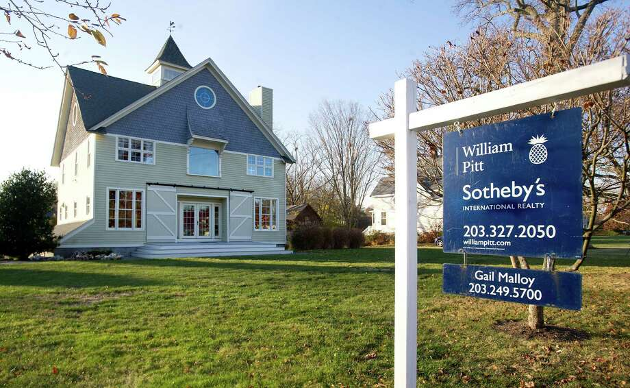 Connecticut Gov. Dannel Malloy's house at 277 Ocean Drive East in Stamford, Conn., is on the market with an asking price of $1.5 million. Photo: Lindsay Perry / Stamford Advocate