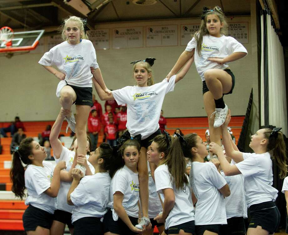 Gold Coast Senior 1 Haywire cheerleaders perform during the Stamford Youth Foundation Cheerleading exhibition show at Stamford High School on Saturday, November 16, 2013. Photo: Lindsay Perry / Stamford Advocate