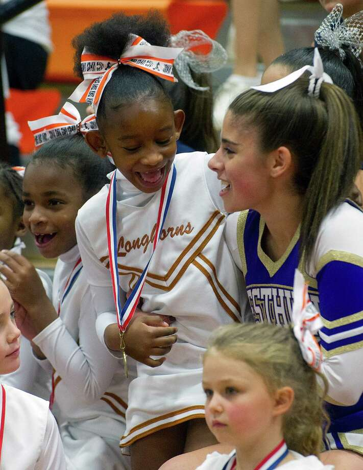 The Stamford Youth Foundation Cheerleading exhibition show at Stamford High School on Saturday, November 16, 2013. Photo: Lindsay Perry / Stamford Advocate