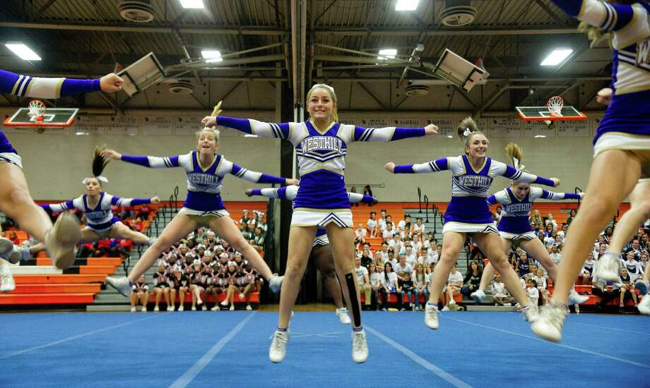 Westhill cheerleaders perform during the Stamford Youth Foundation Cheerleading exhibition show at Stamford High School on Saturday, November 16, 2013. Photo: Lindsay Perry / Stamford Advocate