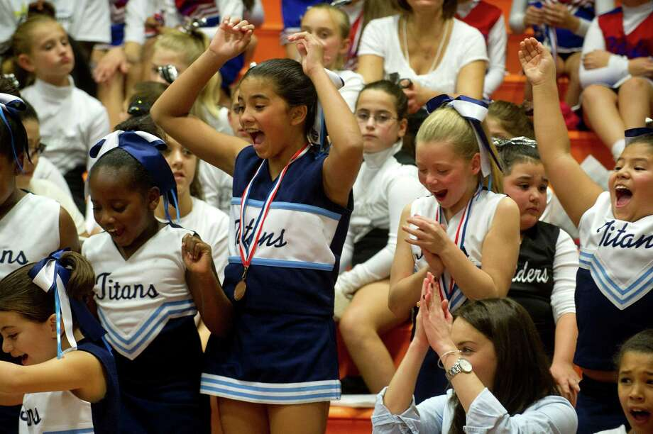 "The Titans with the award for ""Best Spirit"" at the elementary level during the Stamford Youth Foundation Cheerleading exhibition show at Stamford High School on Saturday, November 16, 2013. Photo: Lindsay Perry / Stamford Advocate"