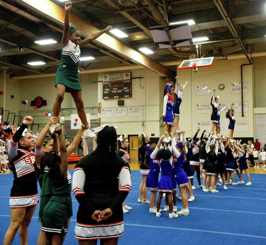 Elementary-aged cheerleaders compete in a longest held extension contest during the Stamford Youth Foundation Cheerleading exhibition show at Stamford High School on Saturday, November 16, 2013. Photo: Lindsay Perry / Stamford Advocate
