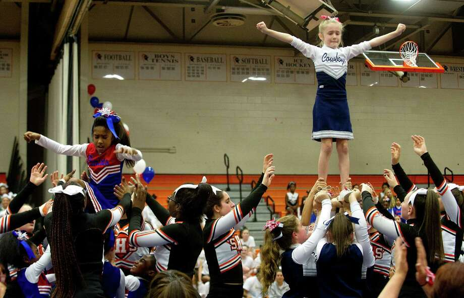 The Cowboys win the longest held extension contest during the Stamford Youth Foundation Cheerleading exhibition show at Stamford High School on Saturday, November 16, 2013. Photo: Lindsay Perry / Stamford Advocate