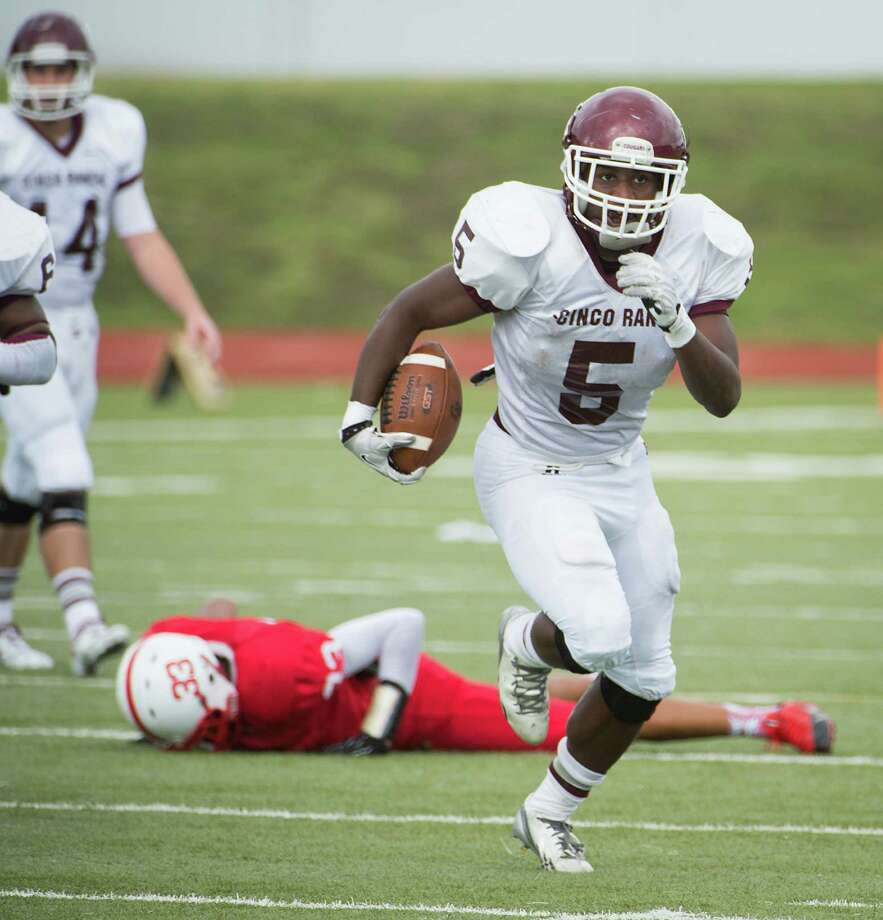 Cinco Ranch running back Denzell Bates (5) races away from Bellaire linebacker Jalon Douglas (33) on a first half touchdown during a high school football playoff game at Barnett Stadium Saturday, Nov. 16, 2013, in Houston. Photo: Smiley N. Pool, Houston Chronicle / © 2013  Houston Chronicle