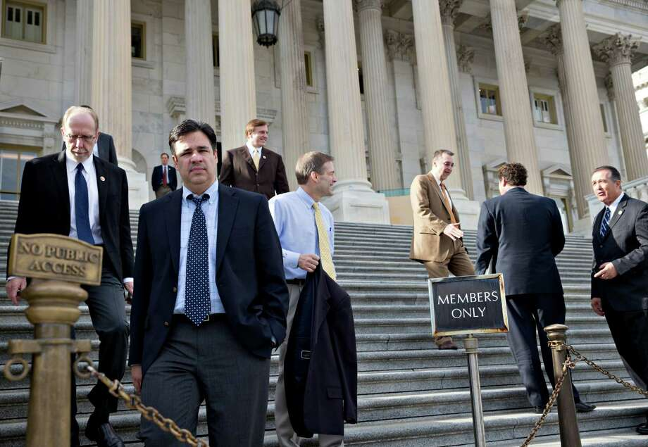 Rep. Raul Labrador, R-Idaho, second from left, and other House members leave after the House voted to let insurance companies sell individual health coverage. Photo: J. Scott Applewhite, STF / AP