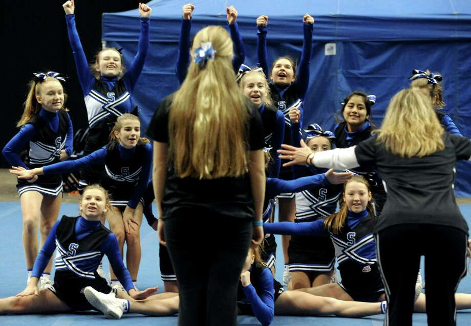 The Saratoga Blue Streak team runs through their routine before competing in the Eastern Region Pop Warner Cheer and Dance Championships at the Times Union Center on Saturday Nov. 16, 2013 in Albany, N.Y. The competition continues at the Times Union Center on Sunday.  (Michael P. Farrell/Times Union) Photo: Michael P. Farrell / 00024616A