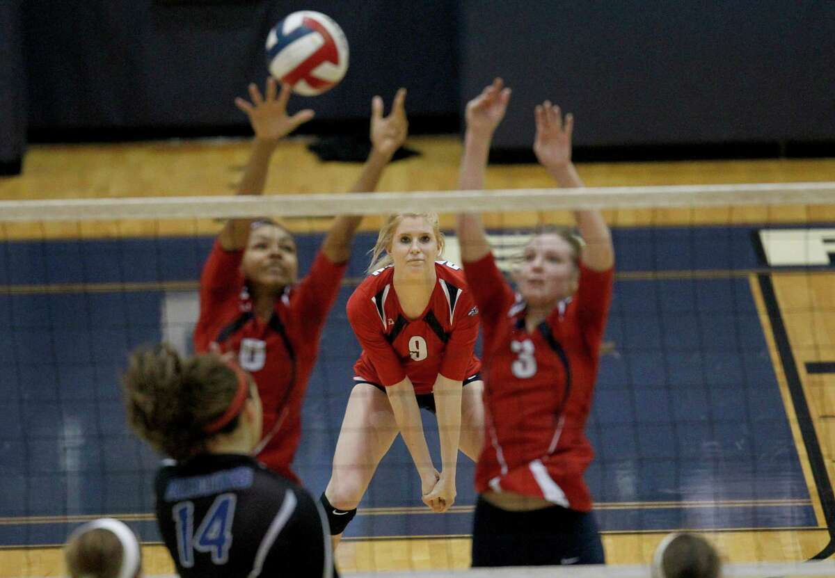 11/16/13: Dawson Chesea Satterwhite (9) watches her teammates return a shot against Friendswood in 4A district volleyball playoff game at Don Coleman Community Coliseum in Houston, Texas. Friendswood won 3 games to 2.