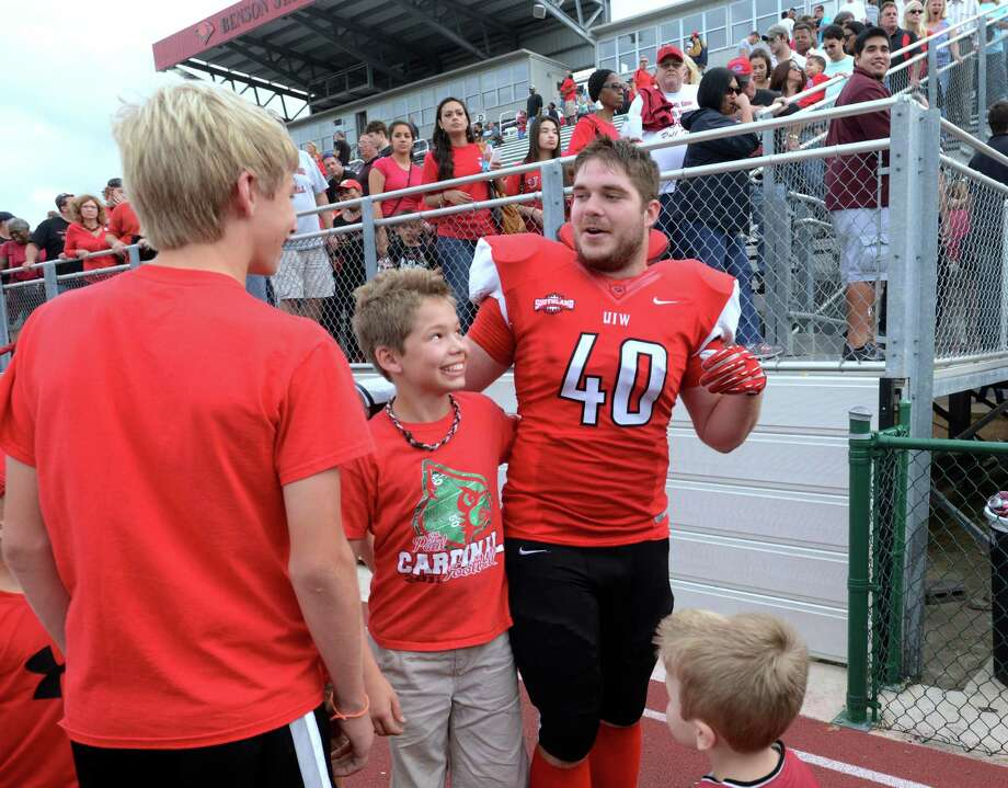 UIW linebacker Nick Morrow greets fans after the game against Angelo State at Benson Stadium on Saturday, November 16, 2013. Photo: Billy Calzada, San Antonio Express-News / San Antonio Express-News