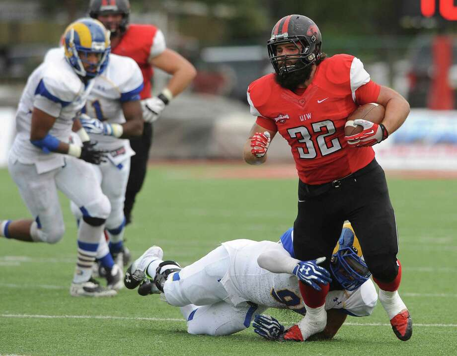 Fullback Matt Bass of Incarnate Word runs for yardage against Angelo State during college football action at Benson Stadium on Saturday, November 16, 2013. Photo: Billy Calzada, San Antonio Express-News / San Antonio Express-News
