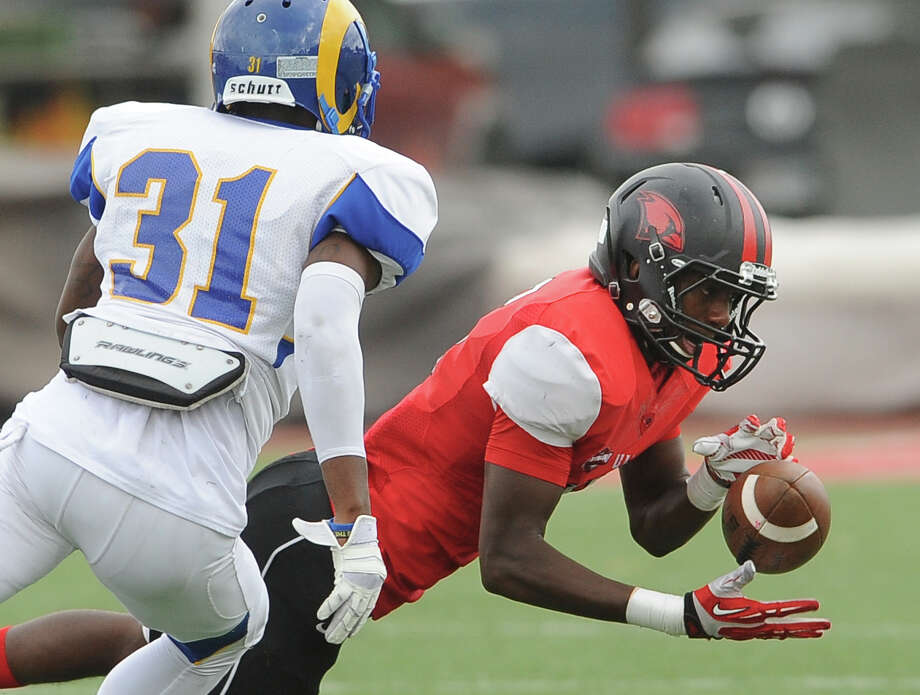 Daryl Brooks of Incarnate Word catches a pass as Jarred Ross of Angelo State defends during college football action at Benson Stadium on Saturday, November 16, 2013. Photo: Billy Calzada, San Antonio Express-News / San Antonio Express-News