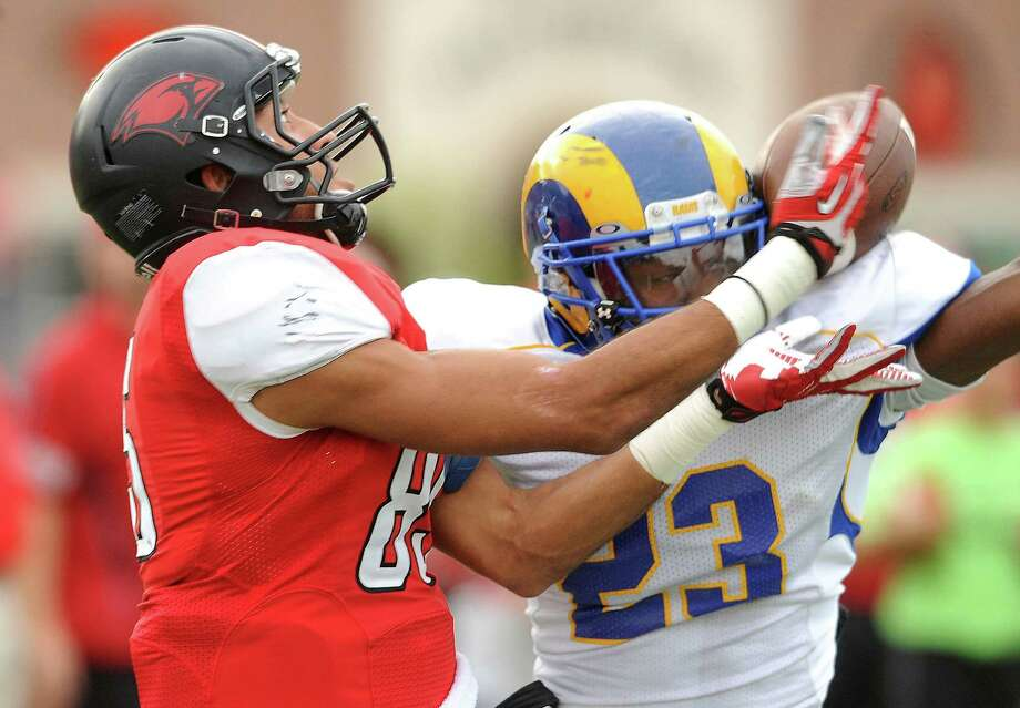 Brandon Yates of Incarnate Word, left, is unable to make the touchdown catch as Nekechie Miller of Angelo State defends during college football action at Benson Stadium on Saturday, November 16, 2013. Photo: Billy Calzada, San Antonio Express-News / San Antonio Express-News