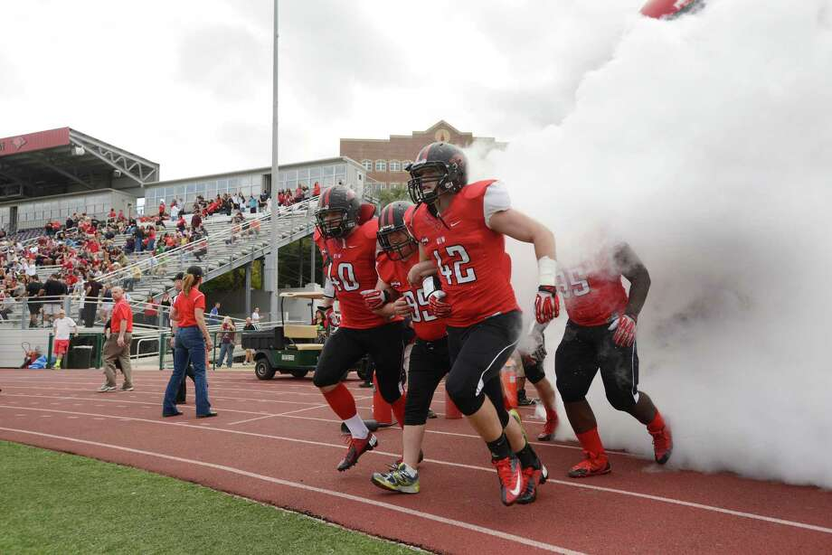 The Incarnate Word Cardinals emerge for their game against Angelo State at Benson Stadium on Saturday, November 16, 2013. Photo: Billy Calzada, San Antonio Express-News / San Antonio Express-News