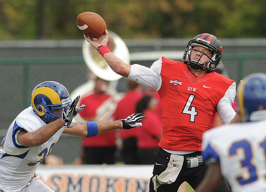 Incarnate Word quarterback Trent Brittain is pressured as he attempts a pass against Angelo State during college football action at Benson Stadium on Saturday, November 16, 2013.