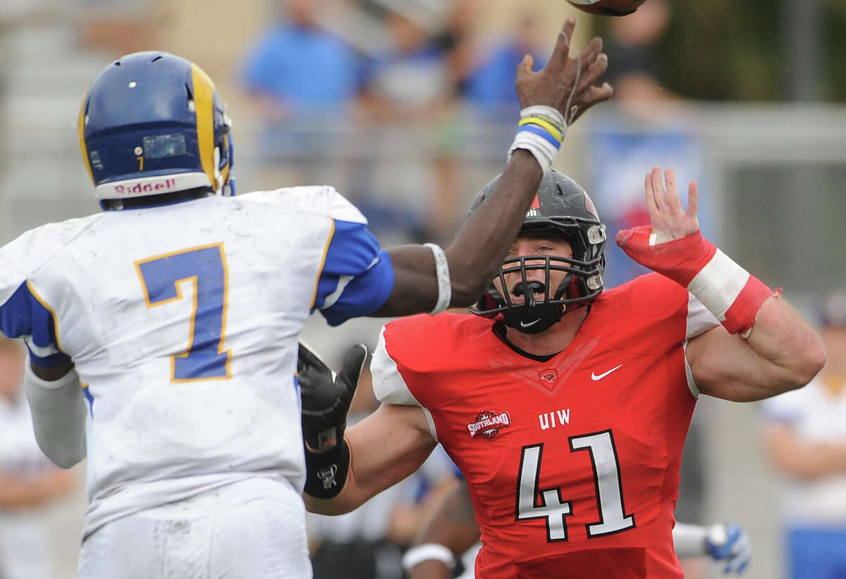 Incarnate Word line backer Robert Moorman pressures Angelo State quarterback Kyle Washington during college football action at Benson Stadium on Saturday, November 16, 2013.