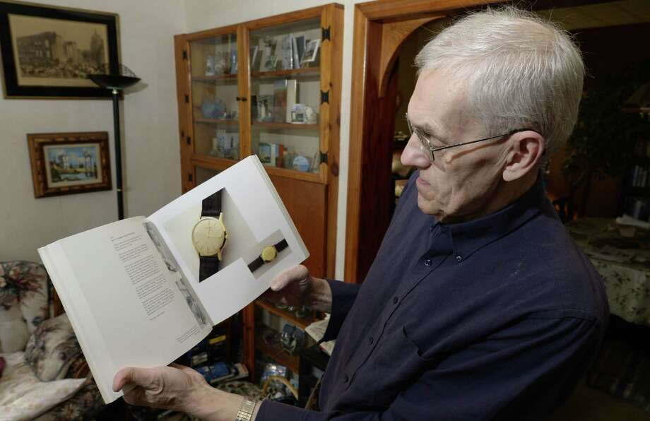 Ed O'Brien holds a book of JFK auction at his home Friday morning Nov. 15, 2013 in Troy, N.Y. These items were from a 1989 auction.    (Skip Dickstein / Times Union) Photo: Skip Dickstein / 00024665A