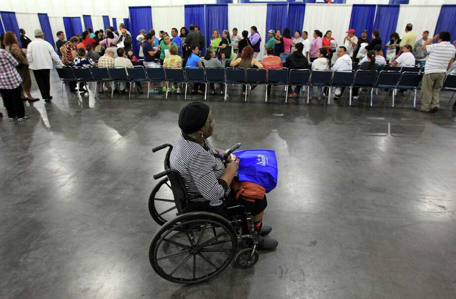 Everglean Thomas, 77, makes her way through the stations as she gets information about the Affordable Care Act during a town hall meeting at George R. Brown Convention Center on Saturday, Nov. 16, 2013, in Houston. Photo: Mayra Beltran, Houston Chronicle / © 2013 Houston Chronicle