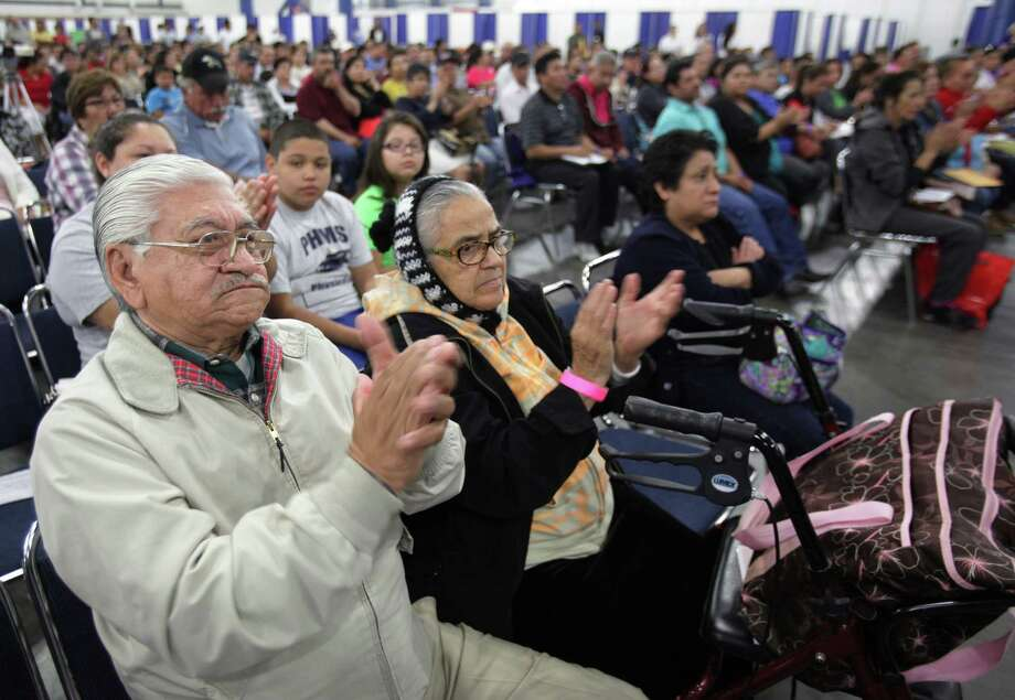 Benjamin Castillo, and his wife Felicitas Castillo, 72, clap in agreement with U.S. Secretary of Labor Thomas E. Perez as he delivers his speech. Photo: Mayra Beltran, Houston Chronicle / © 2013 Houston Chronicle