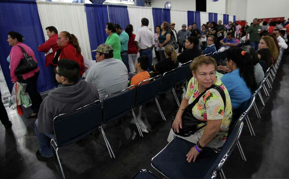 Marian Salegio, 54, has no insurance and waits in line to  enroll for healthcare. Photo: Mayra Beltran, Houston Chronicle / © 2013 Houston Chronicle
