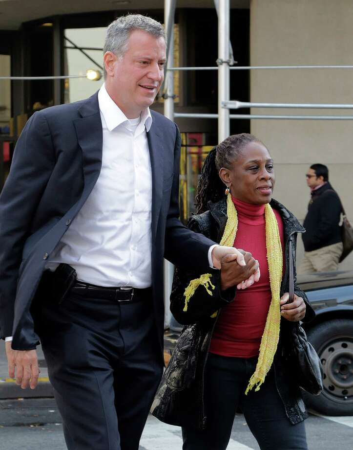 FILE - In this Nov. 6, 2013 file photo, New York Mayor-elect Bill de Blasio and his wife Chirlane McCray hold hands while crossing the street in the Park Slope neighborhood of the Brooklyn borough of New York. De Blasio and his wife settled in Park Slope largely because they felt that their interracial relationship would be accepted there, the mayor-elect has said. (AP Photo/Mark Lennihan, File) ORG XMIT: NY427 Photo: Mark Lennihan / AP
