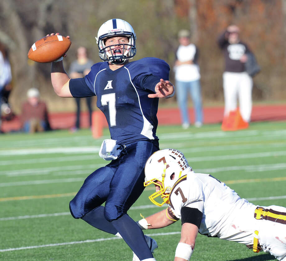 Phillips Academy quarterback Ian Maag, (# 7), left, is pressured by Brunswick Jimmy Knight (# 7) during the Jack Etter New England Football Championship Bowl between Brunswick School and Phillips Academy at Avon Old Farms School, Avon, Conn., Saturday, Nov. 16, 2013. Brunswick lost the championship to Phillips Academy, 35-28. Photo: Bob Luckey / Greenwich Time