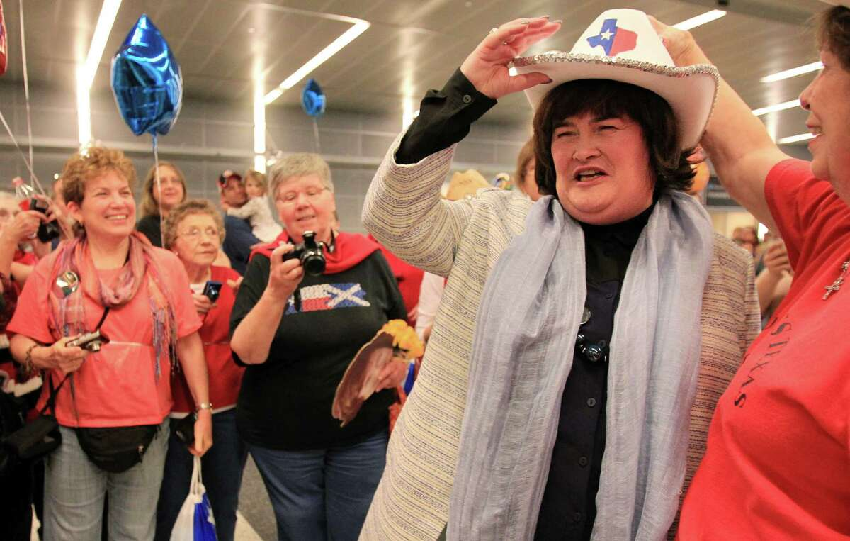 Britain's Got Talent star singer Susan Boyle is receives a cowboy hat after arriving to Bush Intercontinental Airport on Saturday, Nov. 16, 2013, in Houston. Boyle will perform two concerts at Lakewood Church Sunday.