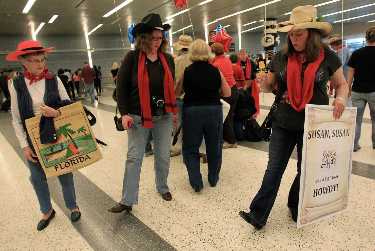 Marge Yount, 85, and daughter Cheryl Yount, 57, of Dallas, get a quick lesson in line dancing from Michelle Eanes, 40, of Austin, while waiting for Britain's Got Talent star singer Susan Boyle to arrive at Bush Intercontinental Airport.