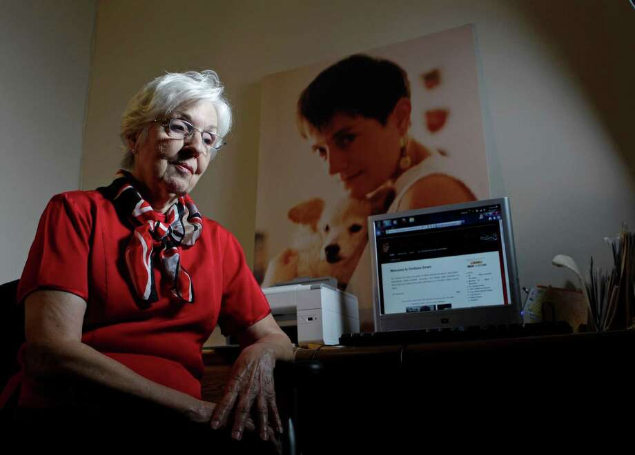 Arlene Kelly's daughter, Colleen, whose photo hangs in her mother's home, is co-founder of the website Civilians Down. Photo: Melissa Phillip, Staff / © 2013  Houston Chronicle