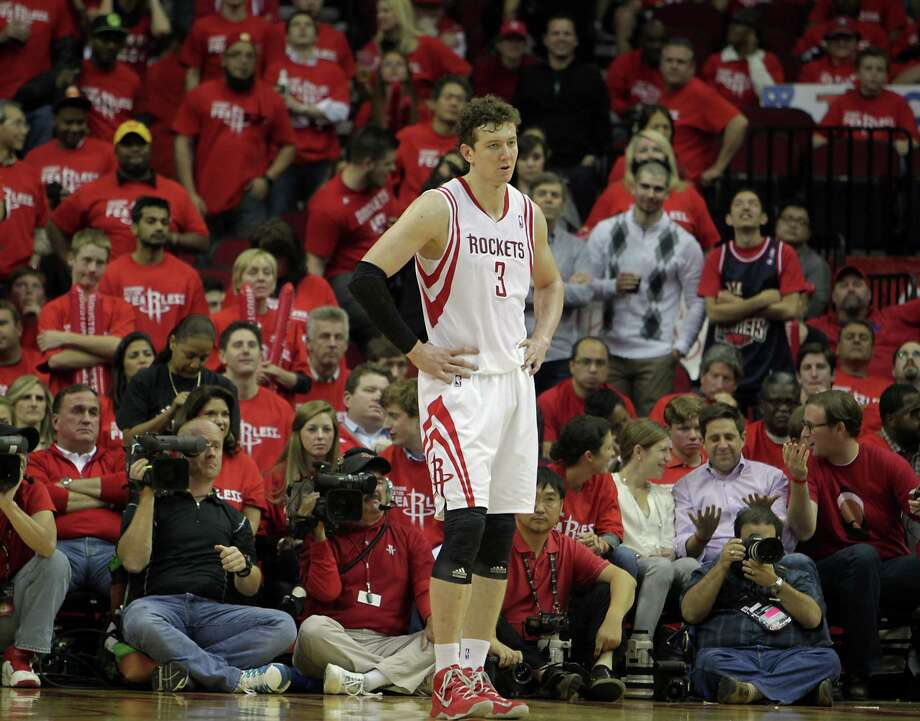 Center Omer Asik has become a disappearing act this season, from starter's minutes to four minutes over the last two games to a no-show for Saturday's game. Photo: James Nielsen, Staff / © 2013  Houston Chronicle
