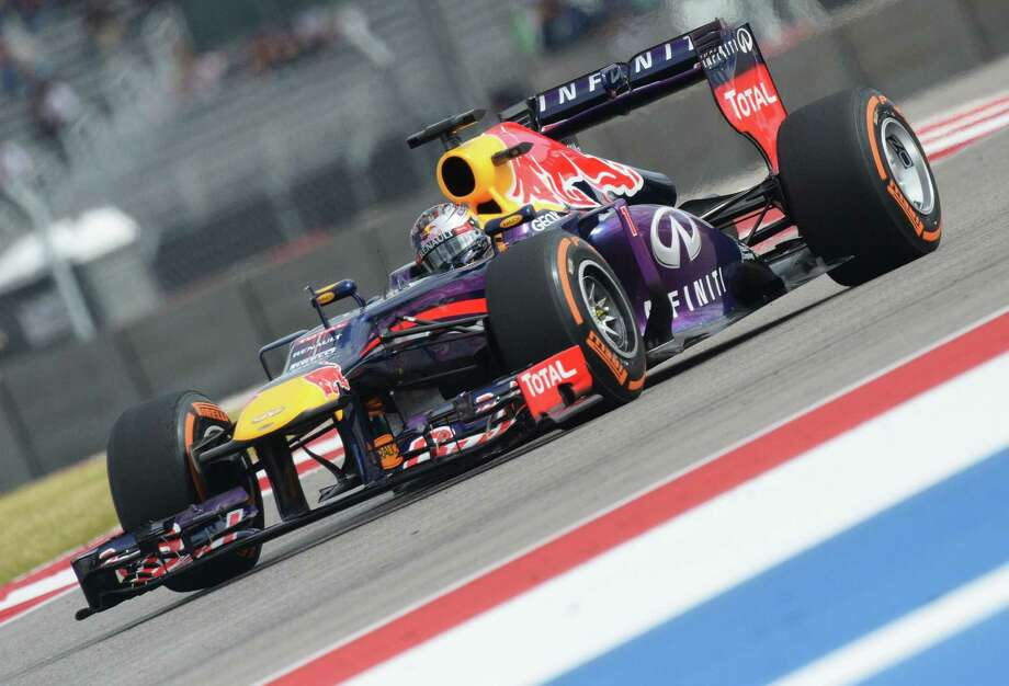 Red Bull driver Sebastian Vettel of Germany grabbed the pole position for the U.S. Grand Prix that will run on the Circuit of the Americas in Austin today. Photo: JOE KLAMAR, Staff / AFP