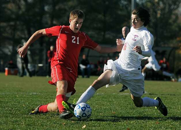 Guilderland's John Hanlon, left, and Fairport's Tom Mousso challenge for the ball in a Class AA state semifinal at Middletown High School on Saturday, Nov. 16, 2013. Fairport advances to the Class AA final after beating Guilderland, 3-1.  (Adrian Kraus / Special to the Times Union)