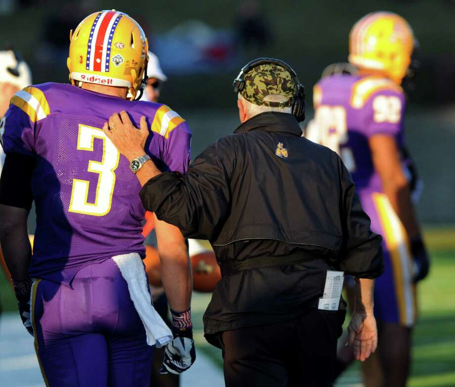 UAlbany coach Bob Ford, right, walks with wide receiver Jake Meek on the sideline during their football game against New Hampshire on Saturday, Nov. 16, 2013, at UAlbany's Ford Field in Albany, N.Y. This is Ford's last home game before he retires at the end of the season. (Cindy Schultz / Times Union) Photo: Cindy Schultz / 00024552B