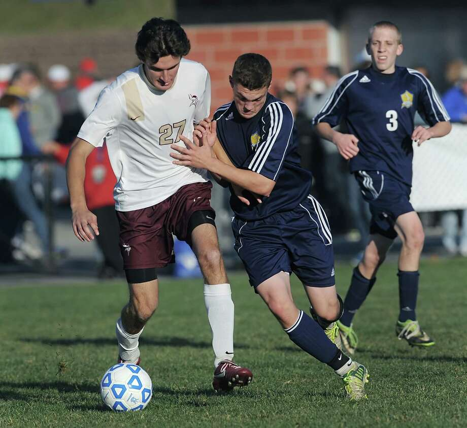 Averill Park's Ben Reinisch, right, pressures Pittsford Mendon's Matt Renzi in a Class A semifinal at the 2013 NYSPHSAA Boys Soccer Championships held at Middletown High School on Saturday, November 16, 2013.  Averill Park was eliminated by Pittsford Mendon-V after a 2-0 loss.  (Adrian Kraus / Special to the Times Union) Photo: Adrian Kraus / © akoPhoto 2011