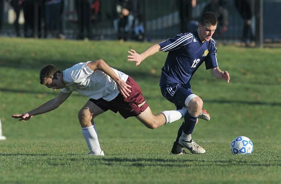 Averill Park's Owen Nuss, right, dribbles the ball away from Pittsford Mendon's John Vangellow in a Class A semifinal at the 2013 NYSPHSAA Boys Soccer Championships held at Middletown High School on Saturday, November 16, 2013.  Averill Park was eliminated by Pittsford Mendon-V after a 2-0 loss.  (Adrian Kraus / Special to the Times Union) Photo: Adrian Kraus / © akoPhoto 2011
