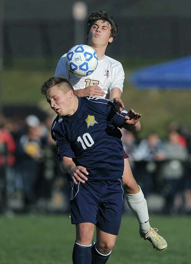 Averill Park's Andres Molinet, bottom, is pressured from behind by Pittsford Mendon's Jack Benotti in a Class A semifinal at the 2013 NYSPHSAA Boys Soccer Championships held at Middletown High School on Saturday, November 16, 2013.  Averill Park was eliminated by Pittsford Mendon-V after a 2-0 loss.  (Adrian Kraus / Special to the Times Union) Photo: Adrian Kraus / © akoPhoto 2011
