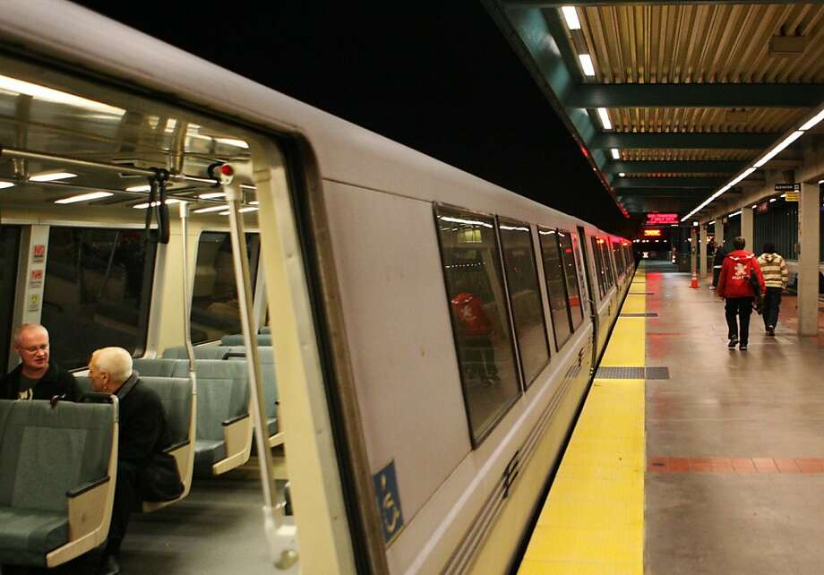 In this file photo, passengers are seen aboard a BART train at the West Oakland station in Oakland. A person was struck and killed by a BART train atthe West Oakland station on Friday night Photo: Raphael Kluzniok, The Chronicle