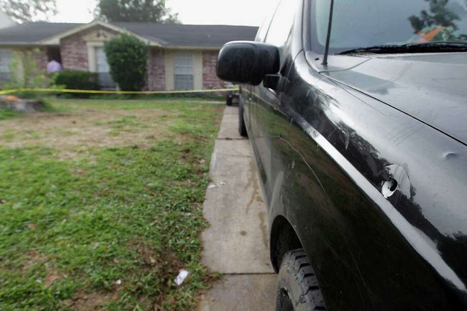 A shooting early Saturday morning outside a party in the 4400 block of Tiffany in southwest Houston left a bullet hole in a pickup truck and the family and friends of 17-year-old Braveon Terry in mourning. Photo: James Nielsen, Staff / © 2013  Houston Chronicle