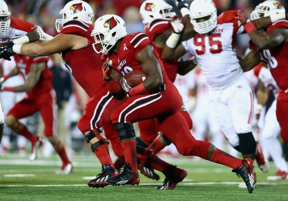 Dominique Brown #10 of the Cardinals runs with the ball. Photo: Andy Lyons, Getty Images